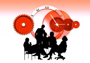 Silhouette of people sitting and networking; clock and gears in background